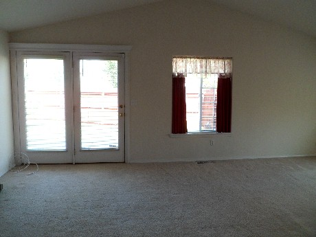 Living area side french doors.